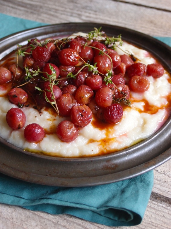 Cauliflower puree with roasted grapes and apple cider vinegar jus