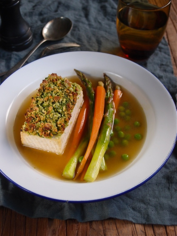 Parsley crumbed tofu in a tarragon broth with spring vegetables